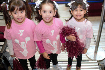 Westpark YMCA Cheerleaders, that includes three Latin's girls, performed a dance at the Q